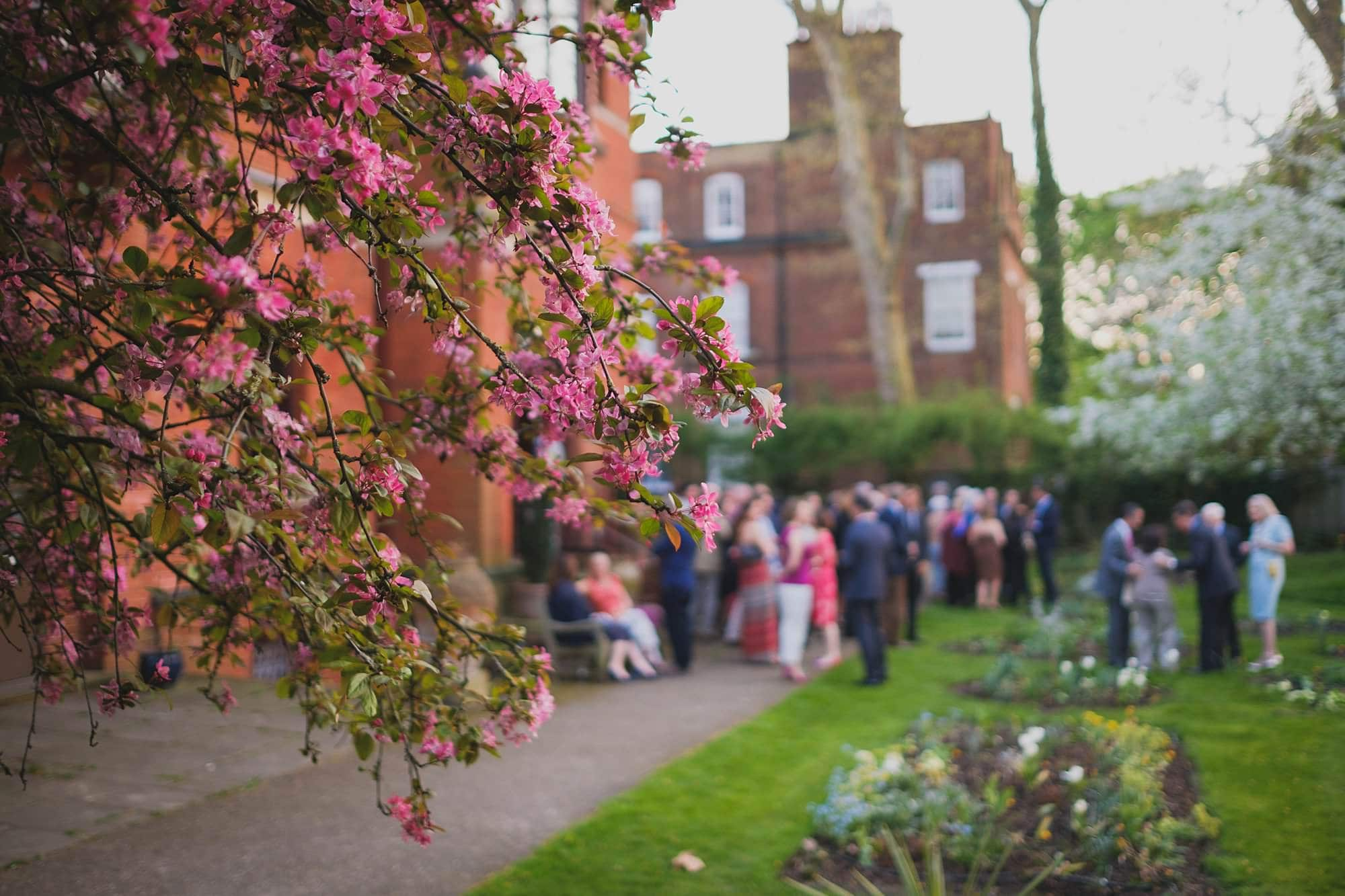 guests in the garden at a leighton house museum event